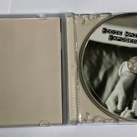 Exposed CD Cover